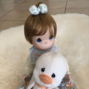 Precious Moments doll with stuffed animal (rabbit)